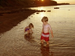 Two children Playing at the beach